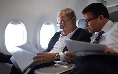 Benjamin Netanyahu and Yossi Cohen look over documents in a photo posted on social media by Netanyahu on December 7, 2015, shortly after he named Cohen as the new Mossad chief. (PMO/Facebook)