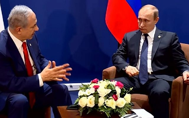 Prime Minister Benjamin Netanyahu speaks with Russian President Vladimir Putin on the sidelines of the COP 21 United Nations conference on climate change at Le Bourget, on the outskirts of Paris, France, on November 30, 2015. (screen capture/YouTube)