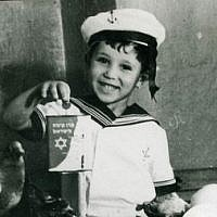 A child holds up a KKL-JNF blue box to collect donations in this undated photo. The blue box was one of the first ways to raise money for the fledgling organization. (Courtesy KKL-JNF)