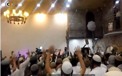Far-right Israeli wedding-goers celebrate the killings of the Dawabsha family (screen capture: Channel 10)