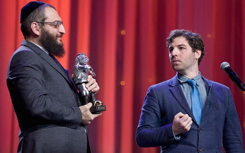 JTA's Cnaan Liphshiz, right, gets set to accept a Fiddler on the Roof Award from Rabbi Boruch Gorin at the Kremlin, Dec. 8, 2015. (Courtesy of the Federation of Jewish Communities of Russia)