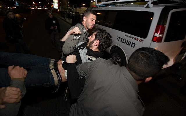 Israeli security forces detain a right wing protester during a demonstration against the arrest of Jewish youth suspected of involvement in the arson attack in the West Bank village of Duma, earlier this summer. December 20, 2015. Photo by Yonatan Sindel/Flash90