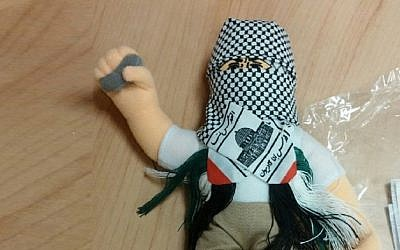 A doll wearing a keffiyah and holding a stone, part of a shipment of 4,000 such dolls heading to the Palestinian Authority which was intercepted by Haifa customs officials, December 8, 2015. (Haifa customs)