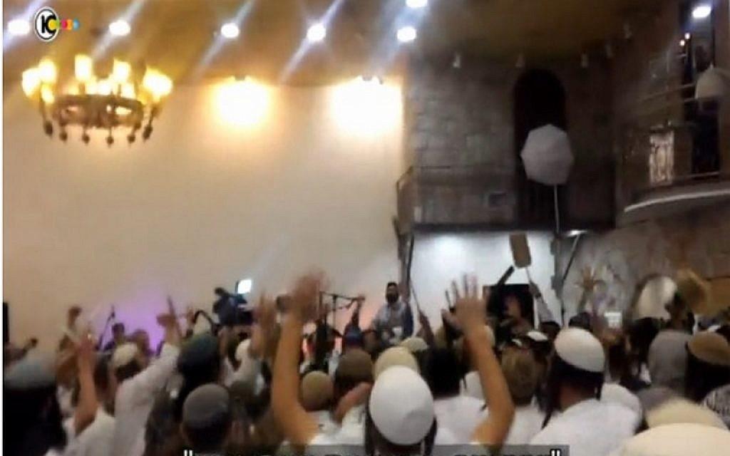 File: Far-right Israeli wedding-goers celebrate the killings of the Dawabsha family, brandishing rifles and calling for revenge against Palestinians, December 2015. (screen capture: Channel 10)