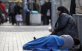 Illustrative photo of a woman begging in Jerusalem. (Nati Shohat/Flash90)