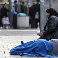 Illustrative photo of a woman begging in Jerusalem. (Nati Shohat/Flash90)