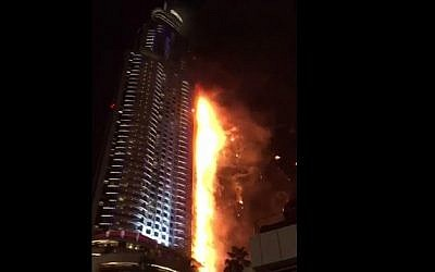 A fire that broke out in a building near a massive New Year's Eve fireworks display in Dubai, December 31, 2015 (YouTube screen cap)