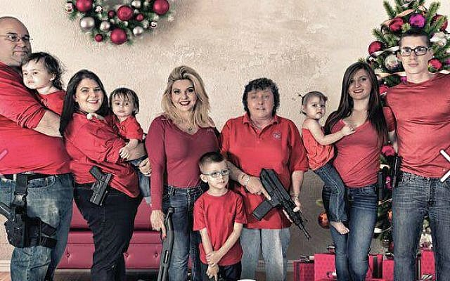 Nevada Assemblywoman Michele Fiore and family pose for Christmas card holding guns, December 1, 2015 (Facebook)