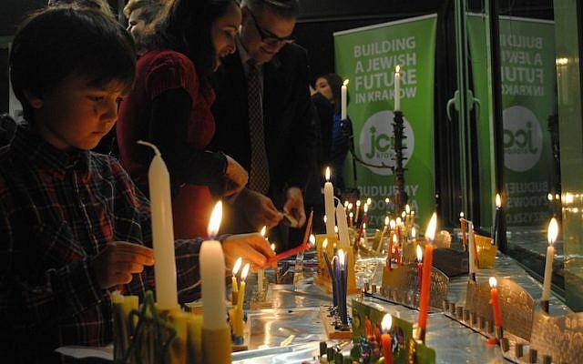 Lighting menorahs earlier this week in Krakow, Poland. (Shavei Israel)