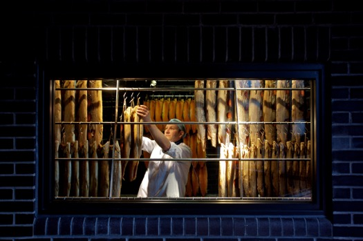 A Formans staffer with the hanging salmon fillets from Scotland (courtesy)
