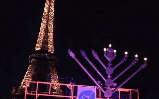 A menorah lighting ceremony at the Eiffel Tower in 2013 (YouTube screen capture)
