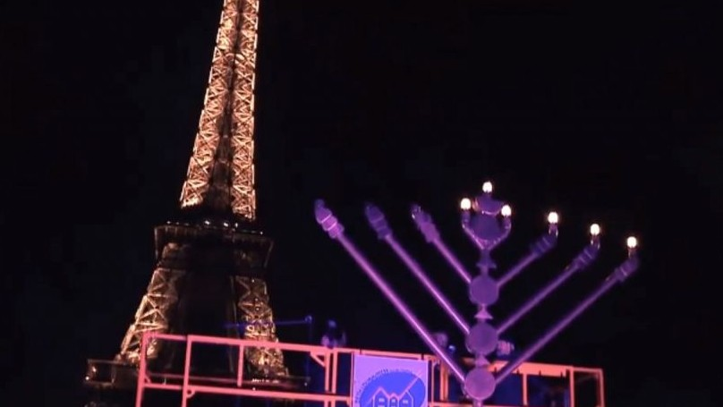 A menorah lighting ceremony at the Eiffel Tower in 2013 (YouTube screen capture) & Rejecting terror threat Paris to light up with Hanukkah ... azcodes.com