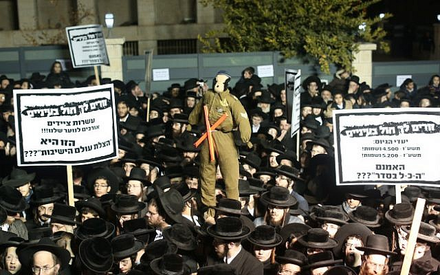 Ultra-orthodox Jewish men protest against the army draft, in Jerusalem's Mea Shearim neighborhood, December 22, 2015. (Yonatan Sindel/Flash90)