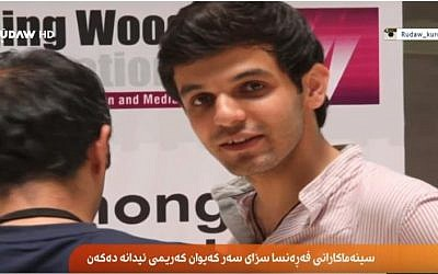 Iranian Kurdish director Kayvan Karimi, 30, faces 6 years in jail and 223 lashes for 'insulting the sacred' for his film 'Writing on the City,' about political slogans daubed on the walls of Tehran's streets. (screen capture: YouTube via Rudaw)