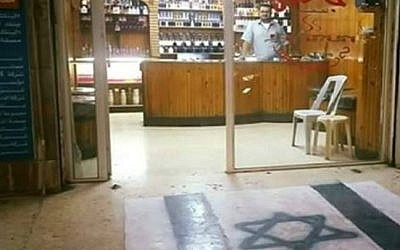 An Irbid, Jordan, shopowner who painted an Israeli flag on the floor of his store. (Facebook screen capture)