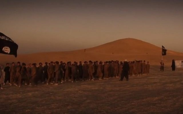 Islamic State fighters are seen marching through a desert in a December 2015 video that presents the jihadist group's version of the apocalypse (screen capture)