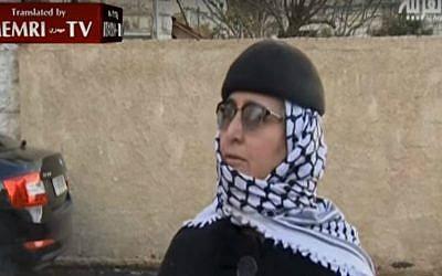 Screen capture showing Kifah Kayyal, ex-wife of terrorist Samir Kuntar, in an interview with Al-Arabiya on December 21, 2015. (MEMRI/YouTube screen capture)