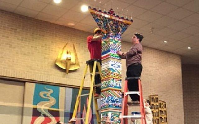 Members of the Texas synagogue Ahavath Sholom put finishing touches on a Lego menorah, Dec. 6, 2015. (Courtesy of Ahavath Sholom via JTA)