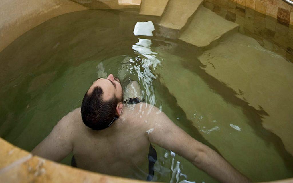 A man using the mikvah at Mayyim Hayyim, a community ritual bath in the Boston suburbs. (Courtesy of Mayyim Hayyim/via JTA)