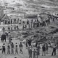 Refugees from France building the Neve Ilan settlement outside of Jerusalem on their first day in 1946. (Courtesy KKL-JNF/Avraham Malovsky)