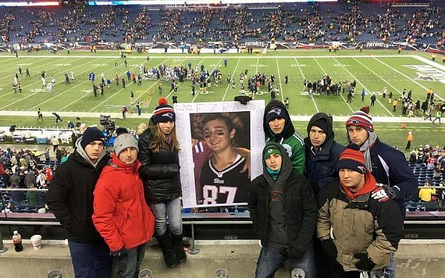 Friends of Ezra Schwartz honor his memory at the November 23, 2015 New England Patriots Game, where a moment of silence was observed for Schwartz (Facebook)