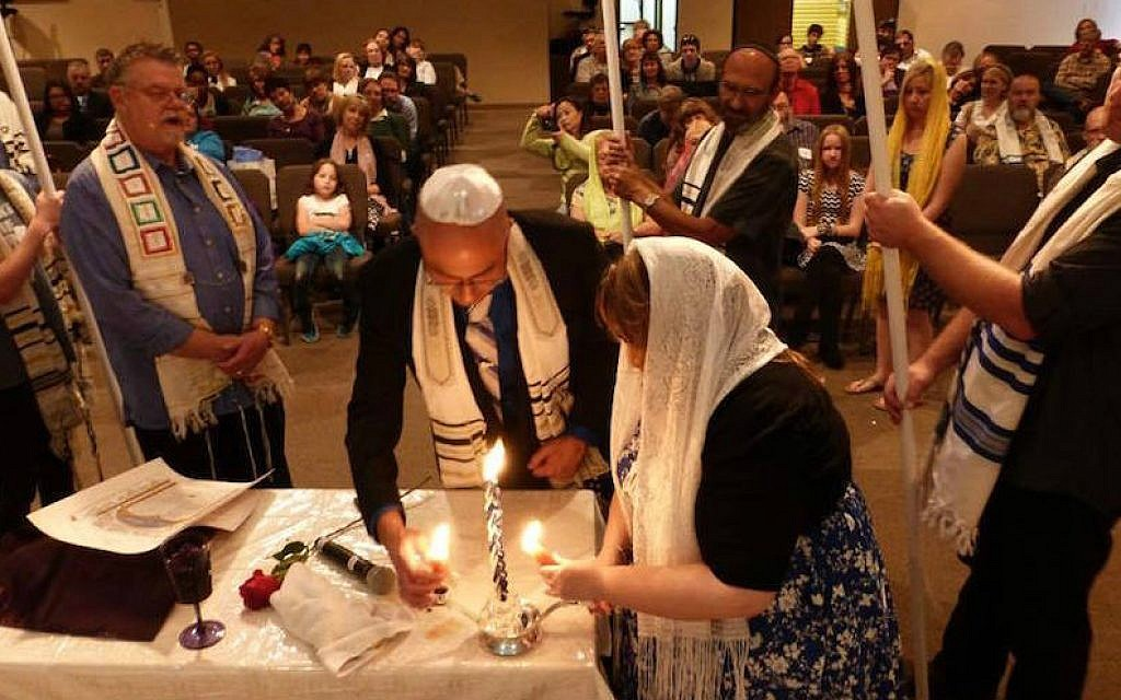 Nicholas Thalasinos renewing his marital vows with his wife at a Jewish-style ceremony, 2013 (Facebook/JTA)