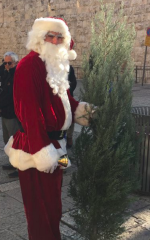 Issa Kassissieh, a former professional basketball player, is Jerusalem's Santa Claus (Jessica Steinberg/Times of Israel)