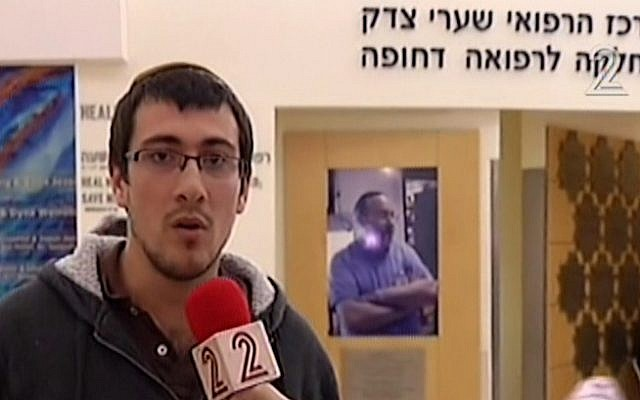 Binyamin Sitbon talks to the media from Shaare Zedek Hospital after his 15-month-old son was wounded in a terror attack at the entrance to Jerusalem, December 14, 2015.  (screen capture: Channel 2)