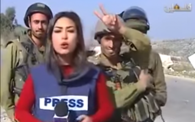 IDF soldiers interrupt the live broadcast of Palestinian journalist Sara Al-Azra, December 14, 2015.  (Screenshot from YouTube)