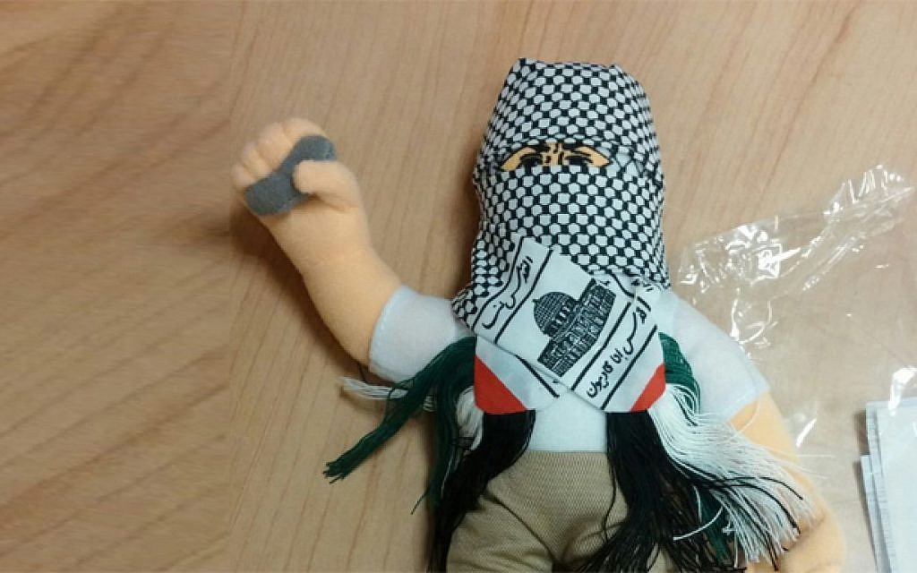 A doll wearing a kufiyah and holding a stone, part of a shipment of 4,000 such dolls heading to the Palestinian Authority which was intercepted by Haifa customs officials, December 8, 2015. (Haifa customs)