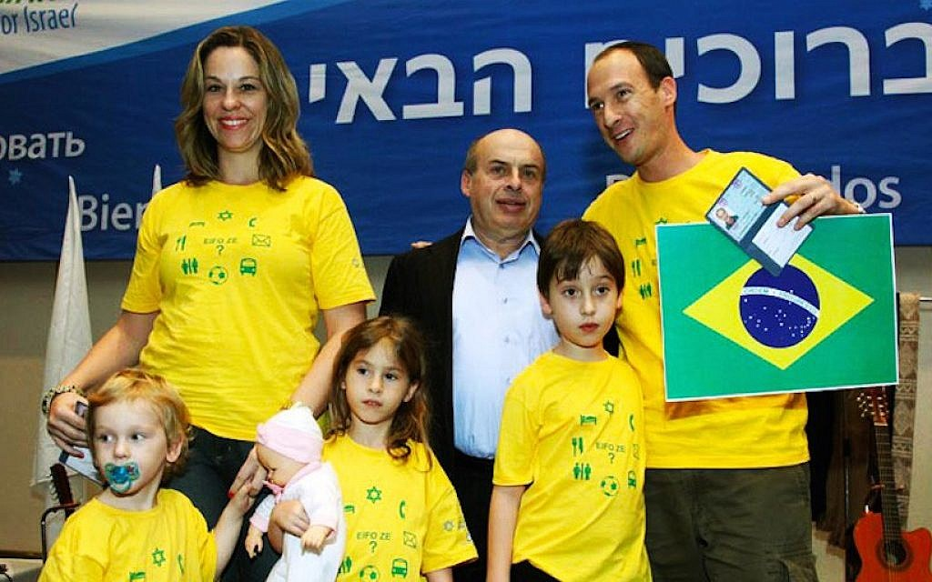 The Teitelbaum family is welcomed to Israel by Jewish Agency Chairman Natan Sharansky in 2010. (Courtesy of Teitelbaum family)