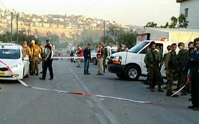 The scene of a car-ramming attack near the Beit Aryeh settlement in the West Bank on December 10, 2015 (Magen David Adom)