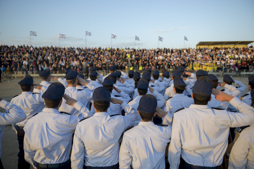 Brand new Israel Air Force pilots salute during the ceremony in which they receive their 'wings' and switch from being cadets to full-fledged pilots at the IDF's Hatzerim air force base near Beersheba on December 31, 2015. (IDF Spokesperson's Unit)