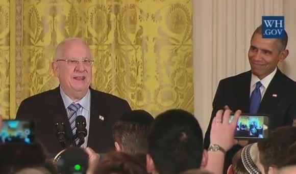 President Reuven Rivlin joins Barack and Michelle Obama at a Hanukkah candle-lighting ceremony at the White House on December 9, 2015 (screen capture: YouTube)