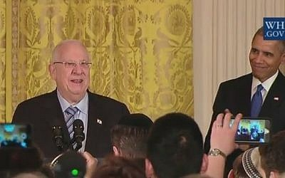President Reuven Rivlin joins Barack Obama at a Hanukkah candle-lighting ceremony at the White House on December 9, 2015 (screen capture: YouTube)