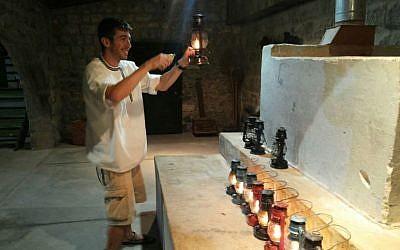 An oil-lamp tour at the Tel Hai Museum (courtesy)