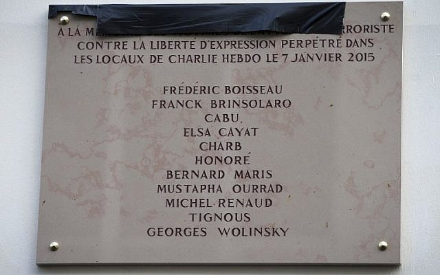A picture taken on January 5, 2016 shows a memorial plaque bearing the names of the victims of the Charlie Hebdo attack on January 7, 2015. (AFP / JOEL SAGET)