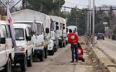 A convoy of aid from the International Committee of the Red Cross (ICRC) waits on the outskirts of the besieged rebel-held Syrian town of Madaya, on January 11, 2016. (AFP/Louai Beshara)