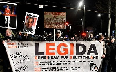 Protesters from the PEGIDA movement (Patriotic Europeans against the Islamization of the Occident) march during a rally in Leipzig, German, on January 11, 2016. (AFP/Tobias Schwarz)