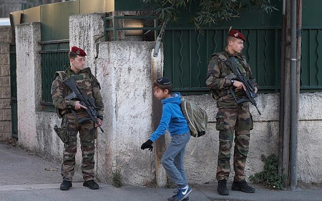 Illustrative: Armed French soldiers secure the access to the 'La Source' Jewish school in Marseille, southern France, on January 12, 2016. (AFP/Boris Horvat)