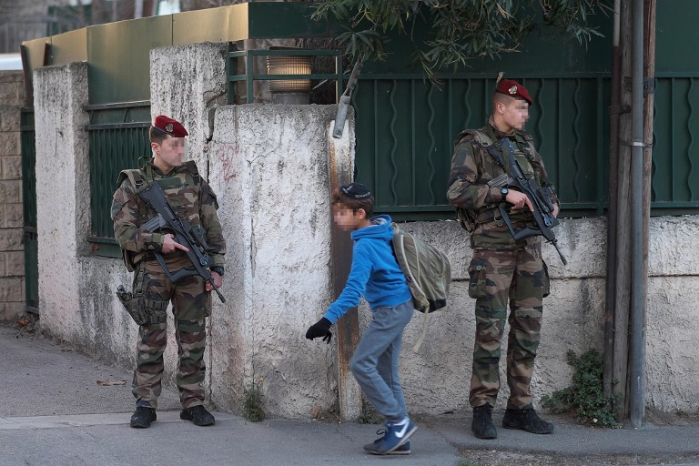 Armed French soldiers secure the access to the 'La Source' Jewish school in Marseille, southern France, on January 12, 2016. (AFP/BORIS HORVAT)