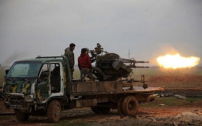Syrian regime forces fire towards Islamic State (IS) jihadists south of the town of al-Bab, in the northern province of Aleppo on January 14, 2016. (AFP/George Ourfalian)