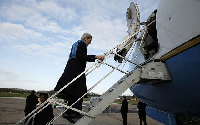 US Secretary of State John Kerry boards a plane in London on January 16, 2016, to travel to Vienna, where the implementation of the Iran nuclear deal is expected following the release of the final report issued by the International Atomic Energy Agency. (AFP/Pool/Kevin Lamarque)