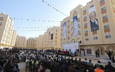 Palestinians attend the opening of the Sheikh Hamad residential project in the southern Gaza Strip town of Khan Younis on January 16, 2016. (AFP/Mahmud Hams)