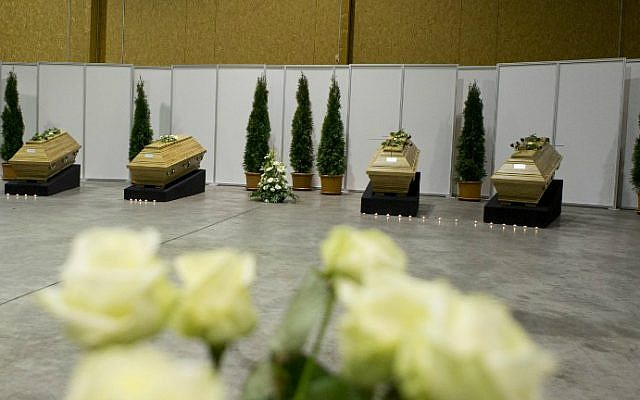 Coffins with the remains of ten German tourists killed in a suicide bomb attack at Istanbul's historic Sultanahmet district are laid out in a hangar at Berlin's Tegel Airport after they were repatriated on January 16, 2016. (Axel Schmidt/Pool/AFP)