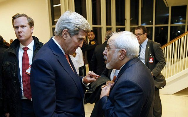 Then-US Secretary of State John Kerry (left) speaks with Iranian Foreign Minister Mohammad Javad Zarif in Vienna, Austria, on January 16, 2016. (AFP/Kevin Lamarque/Pool)