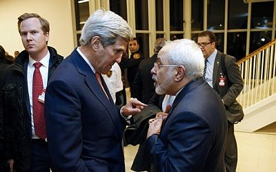 US Secretary of State John Kerry (left) speaks with Iranian Foreign Minister Mohammad Javad Zarif after the UN atomic watchdog verifies that Iran has met all conditions of the July 2015 nuclear deal, in Vienna, Austria, on January 16, 2016. (AFP/Kevin Lamarque/Pool)