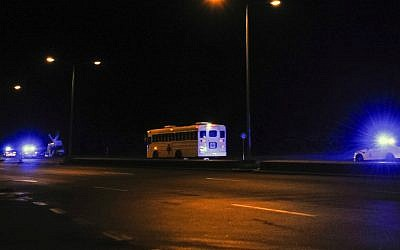 A picture taken on January 17, 2016 shows a medical bus escorted by German and American police leaving the US Air Force at Ramstein, Germany, about a half hour after a plane landed carrying three of four US citizens released by Iran in a prisoner exchange. (Jean-Christophe Verhaegen/AFP)