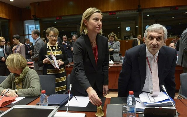EU Foreign Affairs chief Federica Mogherini, center, rings the bell during a EU Foreign Affairs Council meeting at EU headquarters in Brussels, on January 18, 2016. (AFP/John Thys)