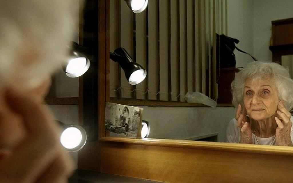 Hungarian Holocaust survivor Eva Fahidi, 90, prepares her make-up in her dressing room of the Vigszinhaz theater in Budapest on 15 January, 2016 (Peter Kohalmi/AFP)